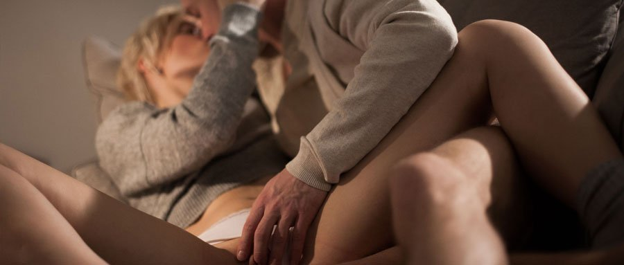 Erotic lovers have sensual sex on a sofa chair