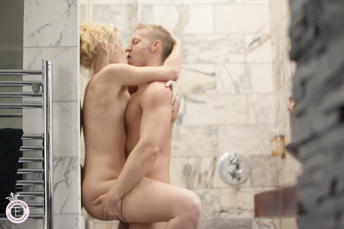 Gorgeous blond couple fuck against shower wall