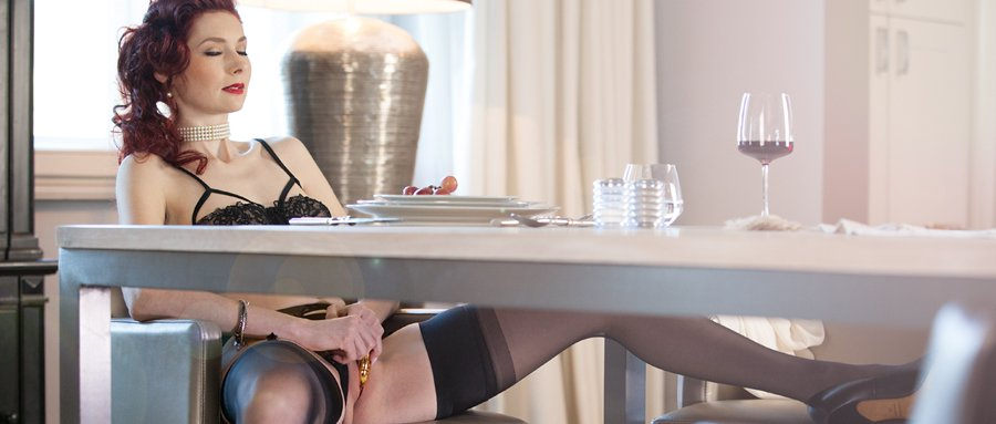 Petite redhead in sexy lingerie teases husband at table