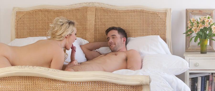 Sexy blonde enjoys sensual lovemaking in bed
