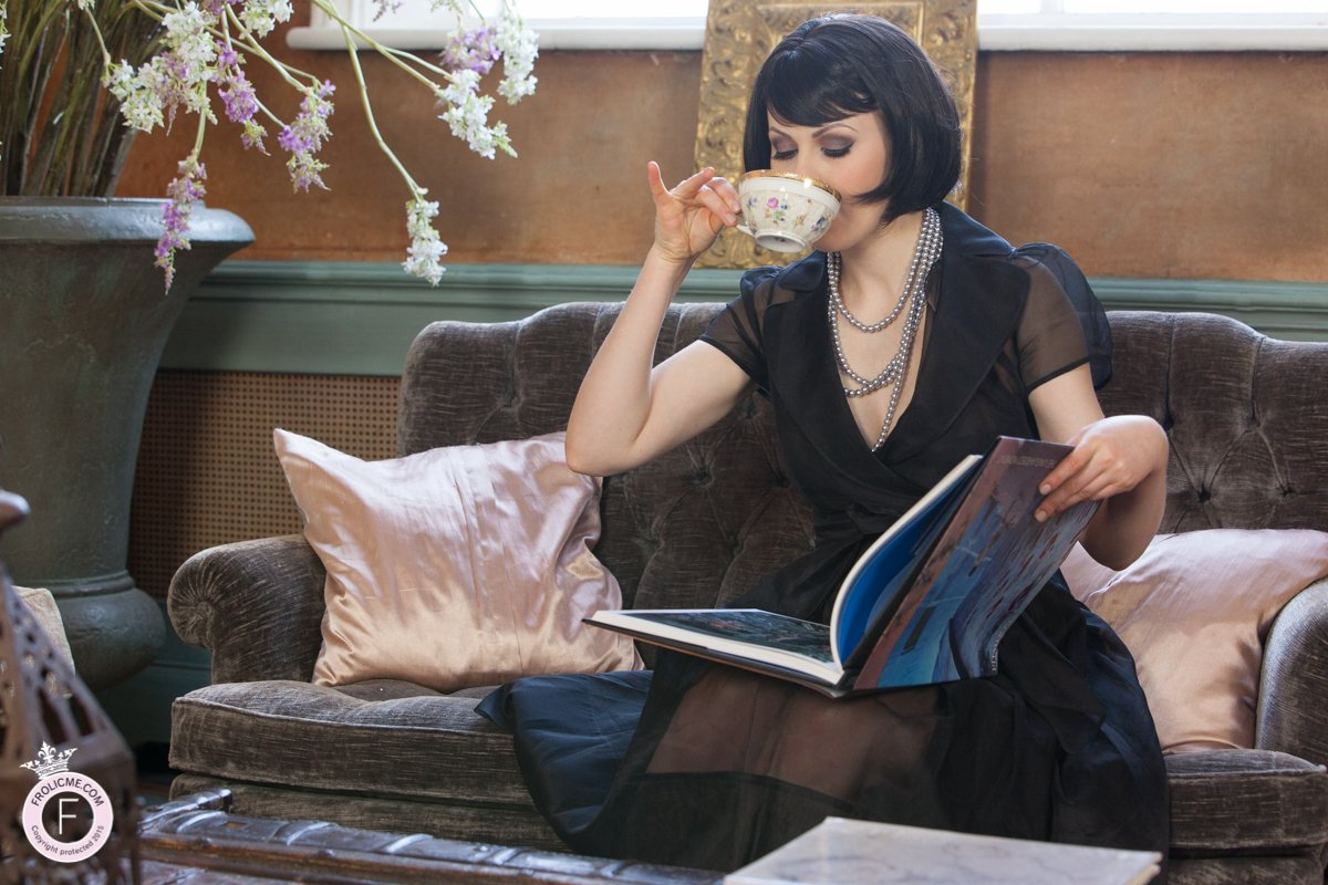 Elegant woman drinking tea