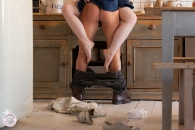 Sensual lovers fuck together on kitchen worktop