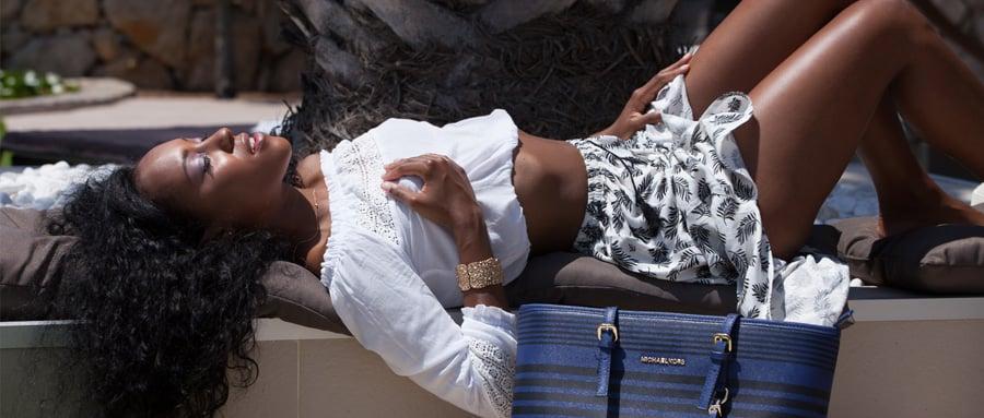 Beautiful black girl enjoys masturbating in the sunshine
