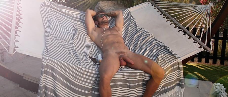 Very sexy naked man masturbating in the sunshine