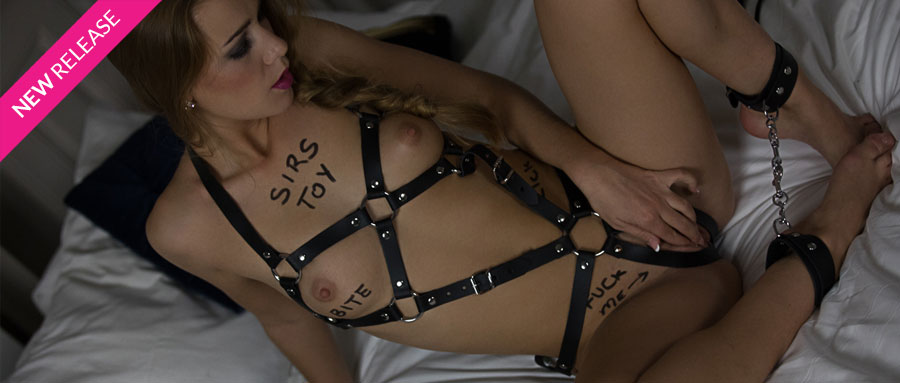 Submissive woman in sex harness | FrolicMe.com
