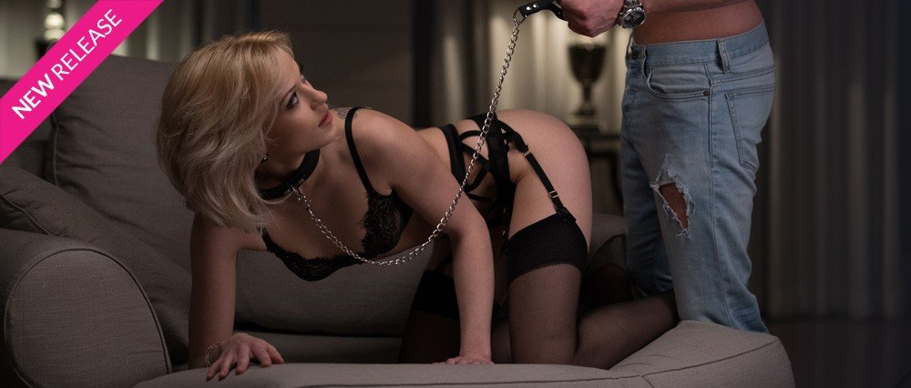 Blonde in lingerie and leather collar and chain