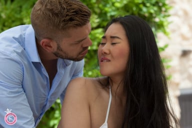 Chinese girl kissing her boyfriend