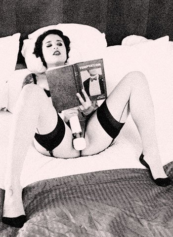 woman-reading-erotica-while-playing-with-herself